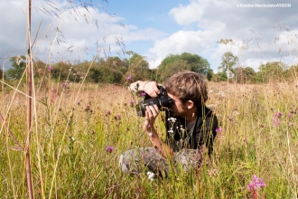 photographer in meadow