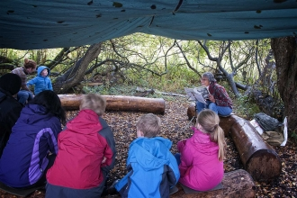 Reading to children at Forest school