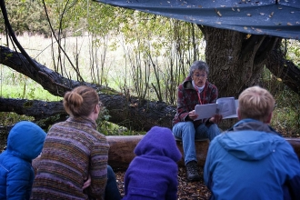 Jane reading at Magor forest school